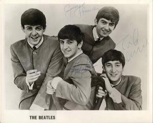 Autographed portrait by all four Beatles