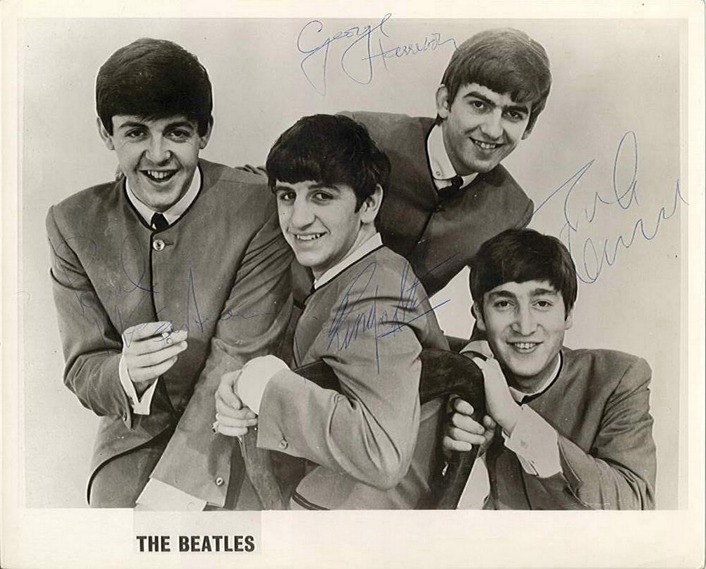 Autographed portrait by all four Beatles
